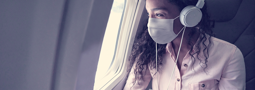 Masked woman on airplane