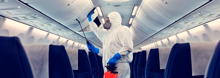 Employee sanitizing airplane